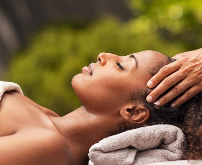 beautiful-african-woman-relaxing-with-face-massage-HJD3AP7