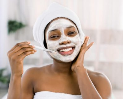 vitamin-facial-mask-african-smiling-woman-with-face-mask-spa_161094-2281